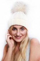 Knitted hat with fur bobble in cream