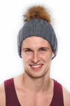 Knitted hat with fur bobble fur bobble