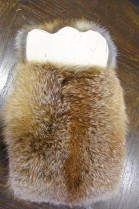 Tablet pocket of red fox fur nature