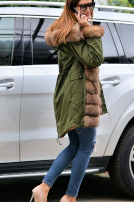 Green parka with an exceptional fox fur in brown