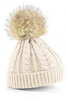 Sand colored bobble hat with light brown fur bobble