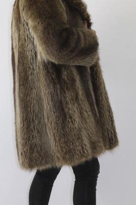 Fur coat raccoon put on brown